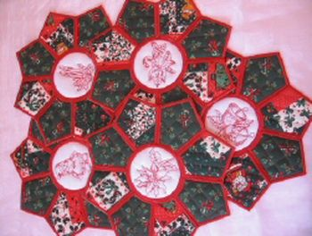 MSP087 - Christmas Placemats Festive, fun and easy to make!  These quick and easy placemats are not only different but a quick project that will brighten any table.  I used plain cotton fabric for the centre pieces and two different Christmas Print Fabrics for the Outer Pieces of the Placemat.  The Centre Pieces can also be used for coasters and you can create a matching set of Placemats and Coasters. http://tinyurl.com/hspud6u