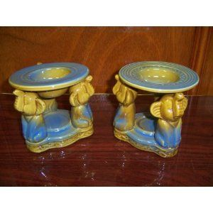 """3 Elephants Style Ceramic Oil Burner and Aroma Diffusers Set of 2 -- 4"""" x 4"""" x 4"""" by Gift Collection. $39.99. Great gift idea and a great addition to any surrounding. Beautifully crafted unique ceramic oil burner set. Measures 4"""" x 4"""" x 4"""". Fragrances your room with your favorite scents. Set of 2 oil burners. Each measures 4"""" tall and 4"""" across. Candles not included."""
