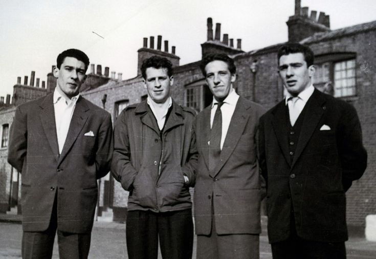 The Kray twins (left and right) with Dickie Morgan (centre right) and another associate in Bethnal Green.