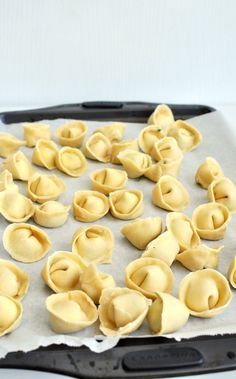 Fresh Tortellini Filled with Basil and Ricotta: Make your own thin, tender pasta parcel, rolled into a beautiful shape and bursting with mildly herby cheese. The tortellini is topped with a pesto, jam packed with basil, walnuts and parmesan.