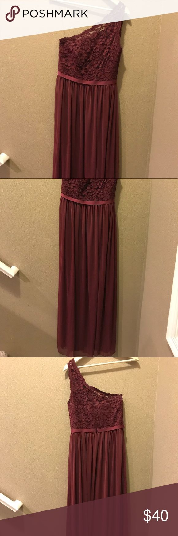 David's Bridal Floor Length Wine Colored Dress One shouldered dress. Top portion of the dress is lace, then bottom half is a chiffon material. There is a leg slit down the middle of the dress. The dress is in very good condition, only worn once! David's Bridal Dresses One Shoulder
