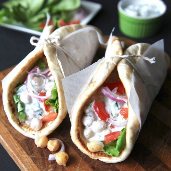 Chickpeas coated with a creamy cucumber dill sauce wrapped up in pita bread makes for the perfect veggie friendly lunch!