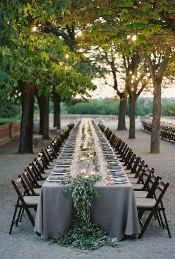 greenery tablescape over blue/grey linens