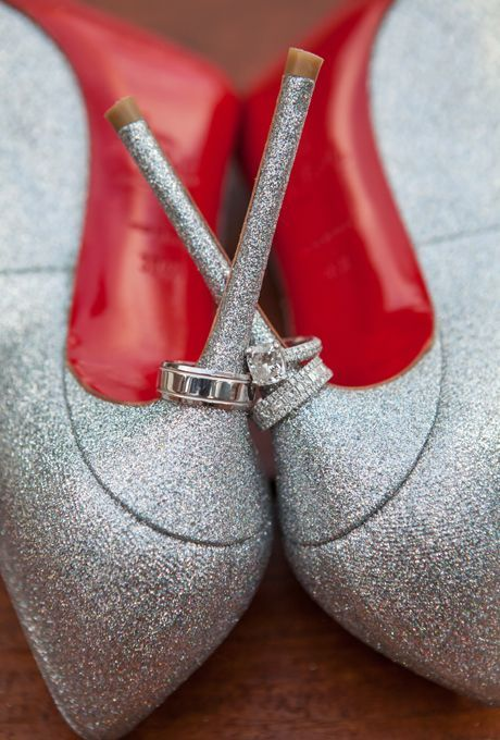 Brides.com: This Week's Best Wedding Ideas: April 4, 2014. Glittery silver pumps add a healthy (and stylish) dose of glam to a white wedding dress. Plus, this pair of Christian Louboutins are fashion and functional, doubling as a stand for the bride and grooms rings. See more photos from Whitney and Ross' destination wedding in Riviera Maya, Mexico here.