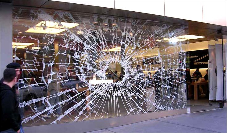 An apple store gets passers by attention with this smashed window effect. Likely to be produced on a clear static cling vinyl - perfect for window graphics and removed without damaging window.