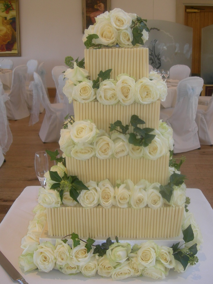 Chocolate wedding cake with a summer theme.