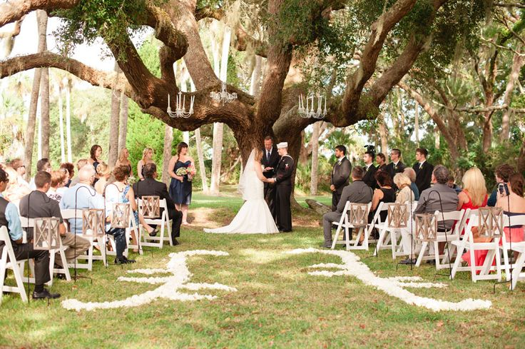 Ceremony Under A Giant Oak With Chandeliers Swaying In The