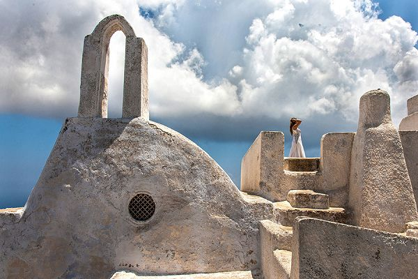 What a stunning picture with architectural sculpture and the bride in the background in Oia village, Santorini island, Greece - selected by www.oiamansion.com