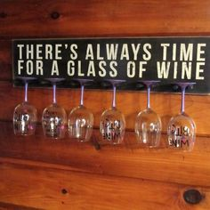 Hangs up on your wall.  Measures about 26x6.5 Holds 6 wine or bar glasses.  Painted Black with white lettering, weathered and stained.  glasses