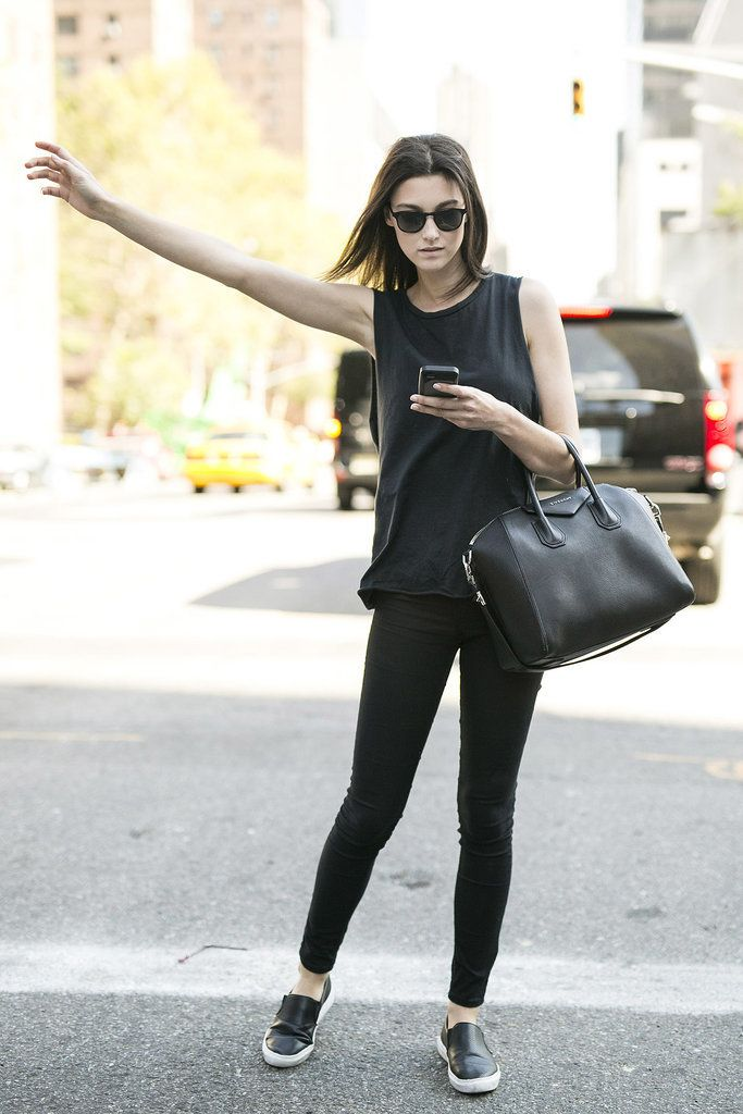 Shop this look for $86:  http://lookastic.com/women/looks/sunglasses-and-tank-and-tote-bag-and-skinny-jeans-and-slip-on-sneakers/3505  — Black Sunglasses  — Black Tank  — Black Leather Tote Bag  — Black Skinny Jeans  — Black Leather Slip-on Sneakers