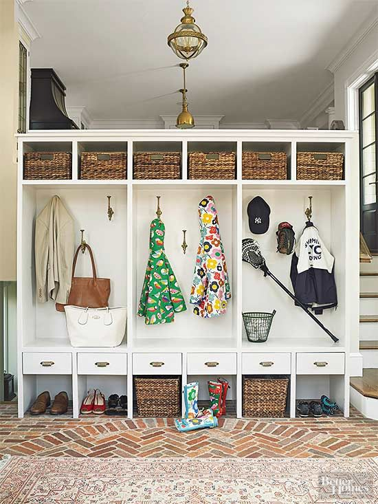 Just inside the mudroom entry at the bottom of the kitchen stairs, lockers serve as an easy-access drop zone for coats, bags, sports gear, and…