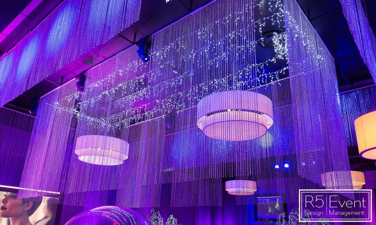 Incredible multi-layer crystal chandelier with beautiful twinkling lights in the centre! Full service event decor by R5 Event Design!