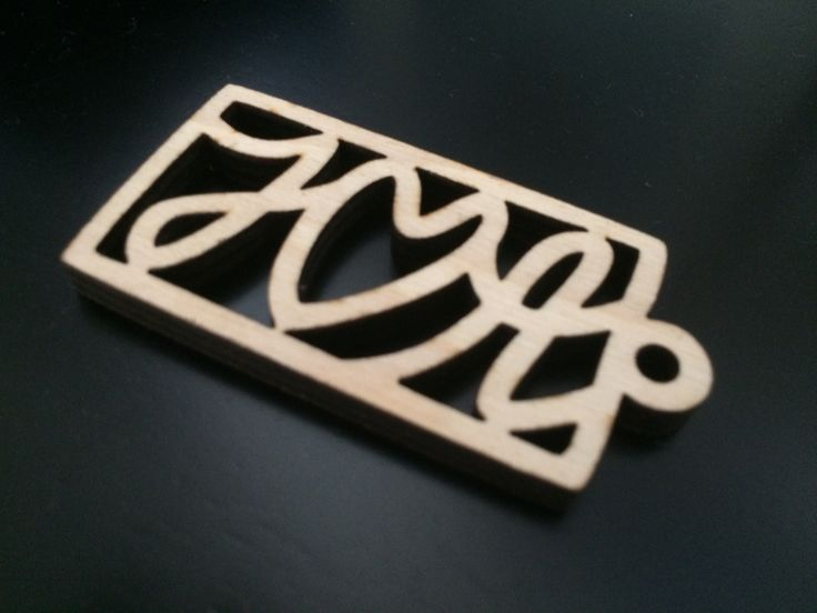 Laser cut keychain. The interesting part was computing the outset a font/bezier curve.