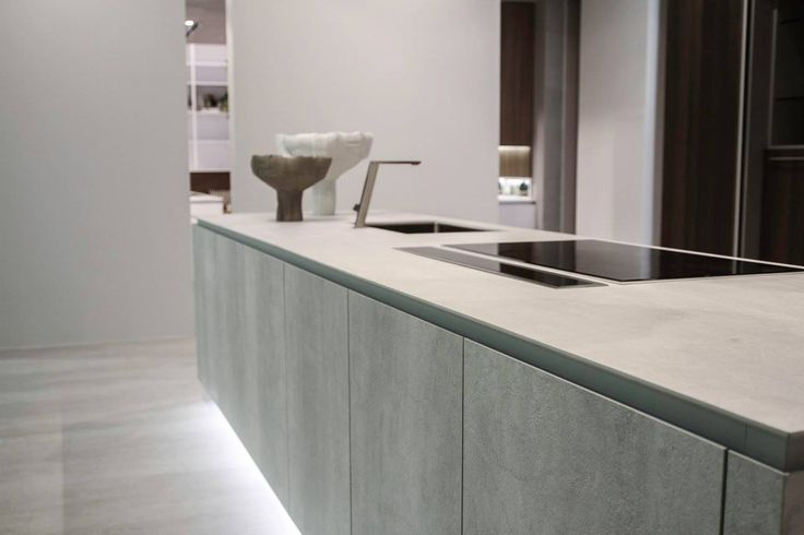 #Kitchen Way at #Eurocucina #Isaloni 2016 with a strict layout and material choice in the name of naturalness: ceramic and wood.