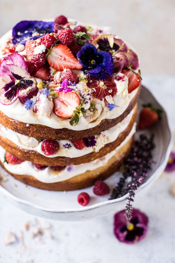 Coconut Eton Mess Cake - Eton Mess, is a traditional English dessert, usually made in a dish, with fresh fruit, smashed pieces of meringue, and cream.