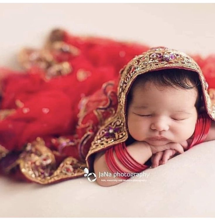 Indian Baby Wrapped In Mothers Wedding Veil Sari Baby Girl Photography Baby Photoshoot Girl Baby Photoshoot