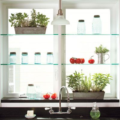 Glass shelves above a deep window sill invite in light while helping to screen the view of a neighbor's house. | Photo: Helen Norman | thisoldhouse.com