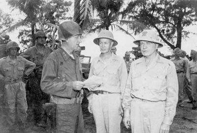 General Paul Mueller welcoming Admiral William Halsey to Angaur, Palau Islands, Nov 1944