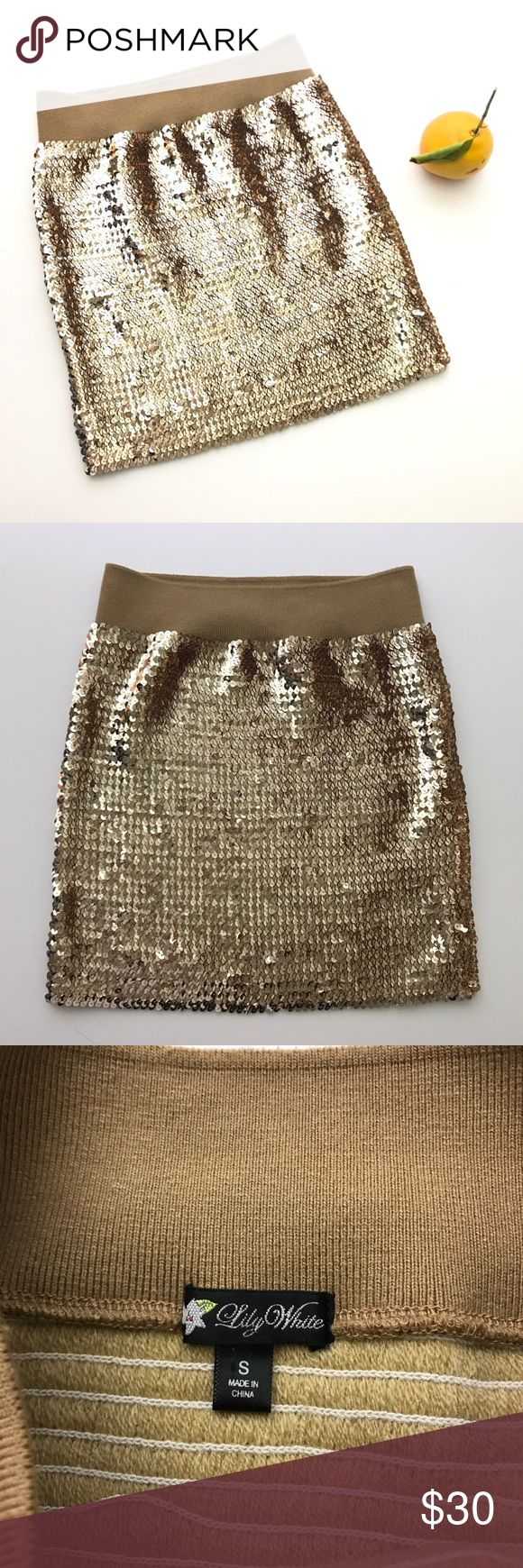 Gold Sequin Body Con Skirt S Lily White - Gold Sequined BodyCon Mini Skirt - Tag says size small, but it is ultra stretchy and could definitely fit a Medium! 🎉 great gently preowned condition- no missing sequins. Elastic waistband and stretchy throughout. Please see photo of drawn diagram for approximate measurements. Thanks! Lily White Skirts Mini