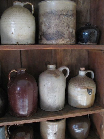 Cupboard...full of old crocks and jugs. Pretty sure I need some like these.