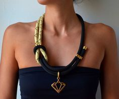 Nautical knot rope necklace in black and gold with gold details and a golden diamond.    The loved accessories are made of 100% love for handmade goods and they are designed espesially for you! So if you want something longer, or shorter, with a different clasp, or even in an other color combination that suits you better, please do ask!    Rope: 10mm  Necklace lenght: 65cm / 25.6in  All the metal parts are nickel and lead free.