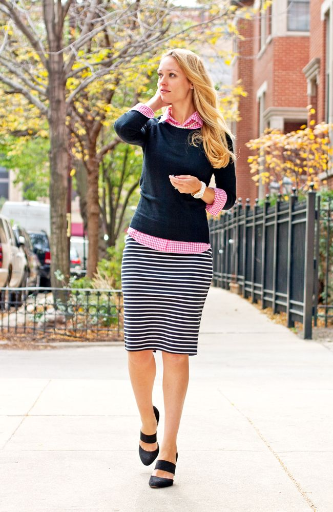 Preppy work wear outfit: striped skirt and a sweater layered over a gingham shirt. (Colorblock pink + navy)