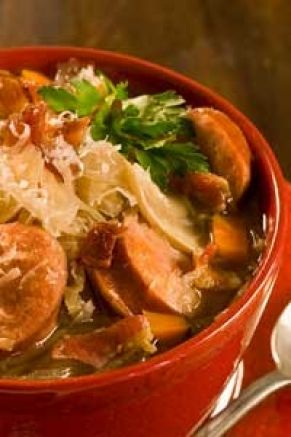 Smoked Sausage & Sauerkraut Soup  Directions:  Stir together all ingredients in a slow cooker. Cover and cook on low setting for 10-12 hours or on high setting for 5-6 hours. To serve, garnish with crumbled bacon and Parmesan cheese and serve with crusty bread.