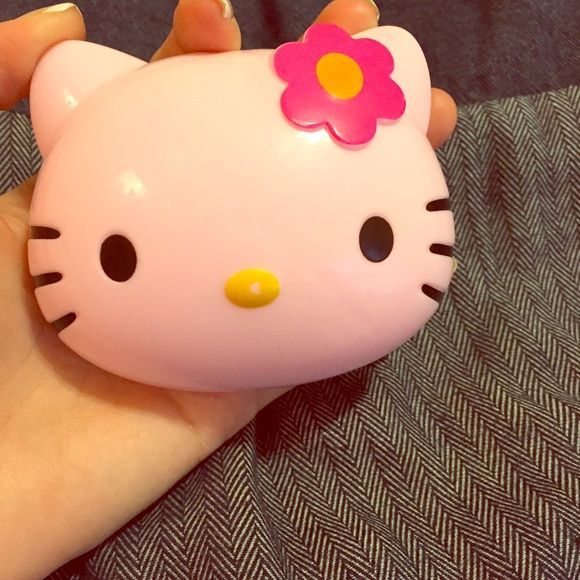 super cute hello kitty contact lens case  Brand New never usedFor Hello Kitty fans or everyone who love cute stuff This is an absolute adorable contact lens case with tools and empty bottle for contact lens solution like travel size. Hello Kitty Accessories