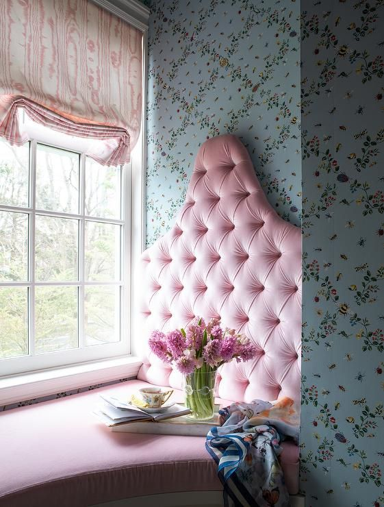 Pink velvet reading nook window seat with a tufted ...