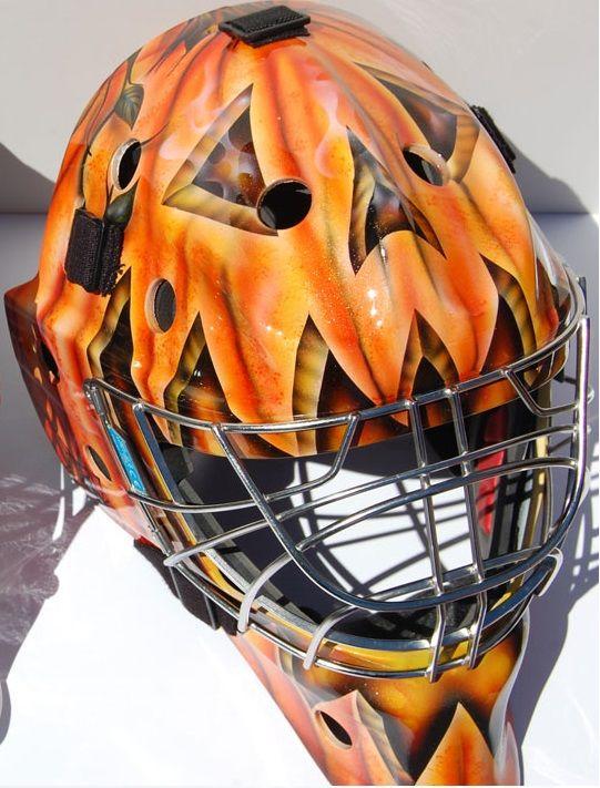 Custom jack o'lantern goalie mask