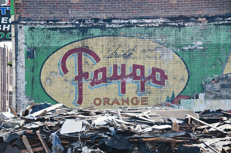 The incredibly colorful and vivid Faygo ghost sign above was recently uncovered on a Detroit liquor store after the neighboring building was demolished. Faygo is a soda product that has been produced in Detroit since 1907, when immigrants Ben and Perry Feigenson developed three soda flavors based on cake frosting recipes they brought over from Russia.