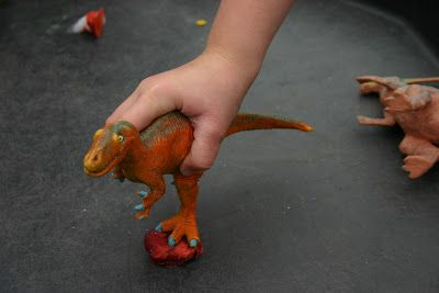 """We made our own Dino Poo, during Dinosaur month! The kids loved getting their hands messy with the flour and water mixture and pretended that """"the poo"""" was stinky!! After baking, the kids then enjoyed crunching the dino poo with their hands and stomping on them with the dinosaurs. It was a great 2-part sensory/small world play activity."""