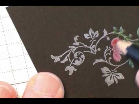 stamping white pigment on black cardstock adding watercolor pencil color