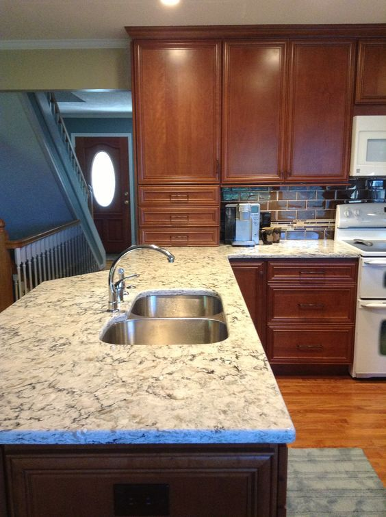 Kitchen With White Cabinets And Quartz Counter Tops Medium Brown Cabinets With Berwyn Cambria Quartz Photos