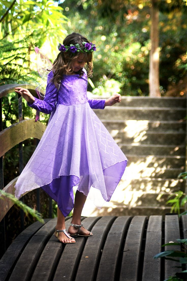 The long sleeved sequin dress in purple.