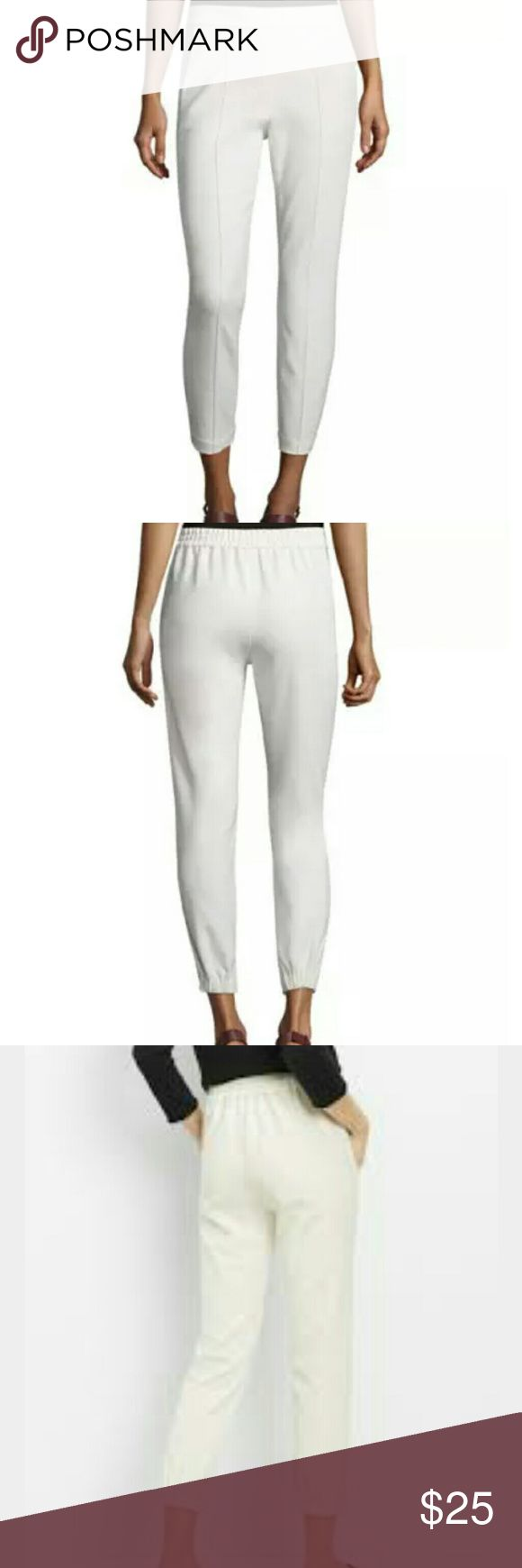 Vince| Easy Pull On Pants Ivory Read! Must have work pants! Exposed seamed detail with tapered legs. Elastic back, chic and comfortable.  Dry clean. Retail for $275. These are Reduced to Clear! They have a slight dark spot from storage. Will come off with dry cleaning! Priced accordingly because they must be dry cleaned when you buy them. Please look at the last two pictures.  48% curpo 36% lyocell 12% cotton 4% elastane Vince Pants Ankle & Cropped