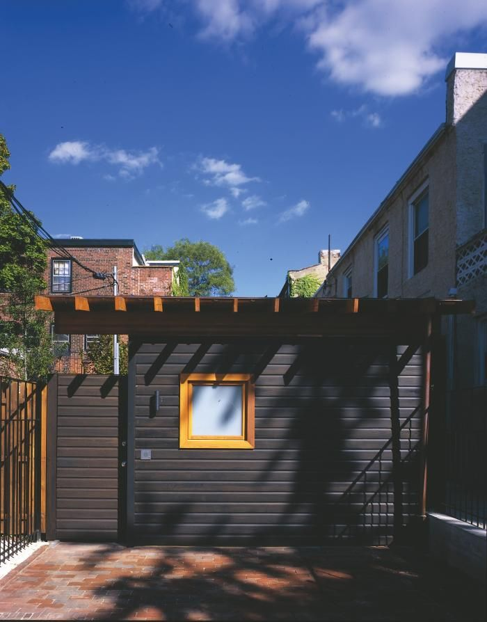 A garden shed in Philadelphia whose western red cedar siding has been stained black.