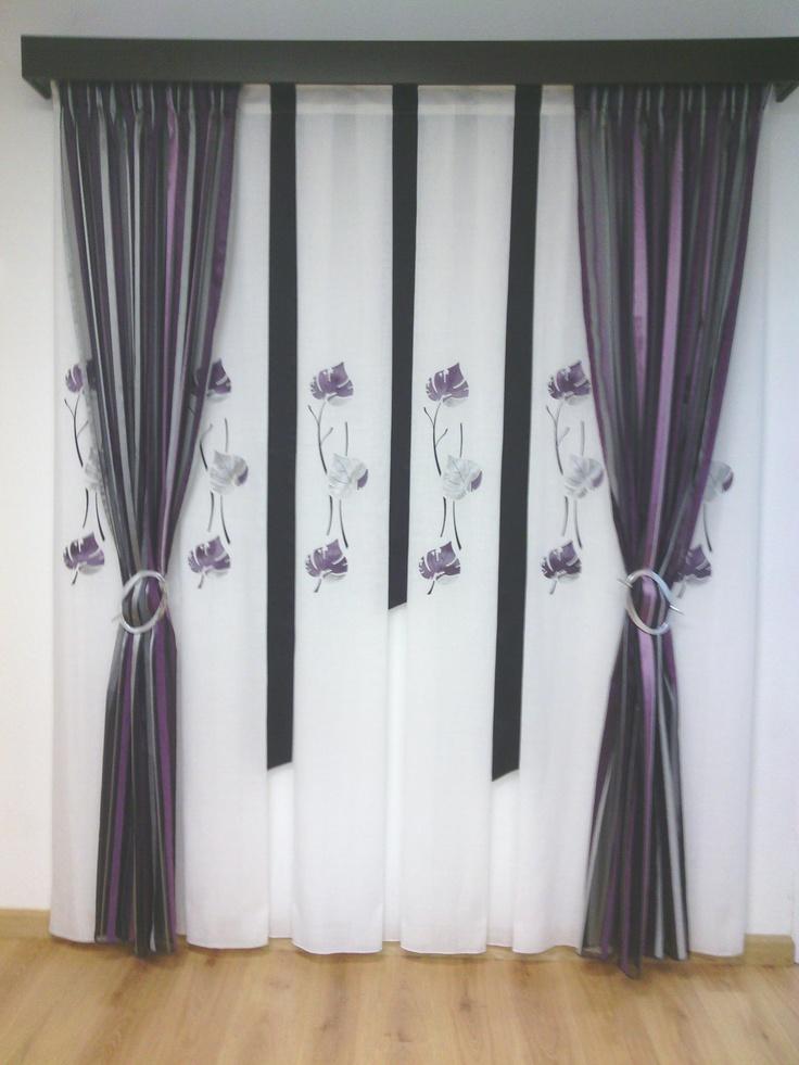 cortina de tabla ancha con aplicacin de piel en tonos morados negros y plateados