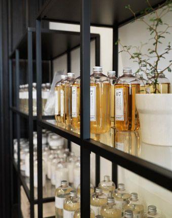 Close-up of VITTSJÖ shelving unit with glass bottles ikea shelves