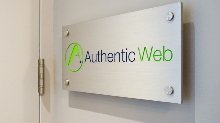 A Wall Reception Sign we completed for Authentic Web. Fabricated of Brushed Aluminum with 2 colour fill engraving and stand-off hardware.