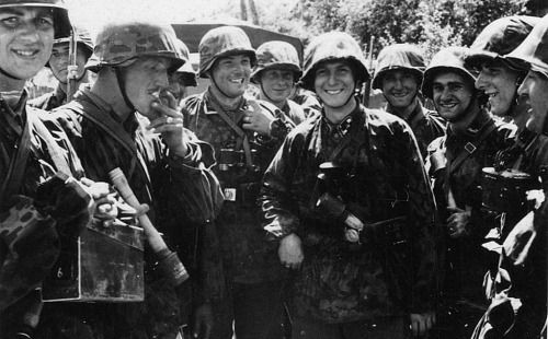The members of the Leibstandarte shown here have been caught on camera while entering a Russian village soon after the start of Operation Barbarossa in the summer of 1941.