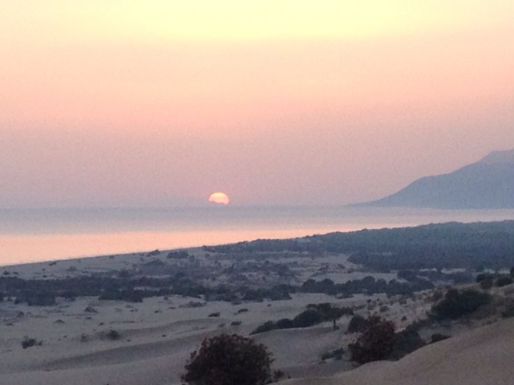 Sunset behind Rhodes, view from patara beach, Turkey