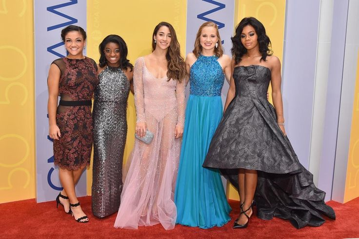 Olympic gymnasts Laurie Hernandez, Simone Biles, Aly Raisman, Madison Kocian, and Gabby Douglas all traded in their leotards for stunning dresses to attend the 50th annual CMA Awards on Nov. 2, 2016.
