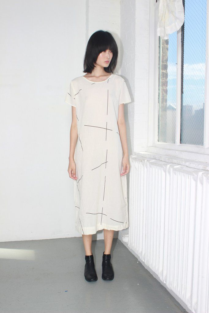 The Tee dress from UZI is an elongated classic that is both universally flattering and laid back. UZI's signature fabrics have a slightly crinkled effect, which makes their pieces perfect for travel.