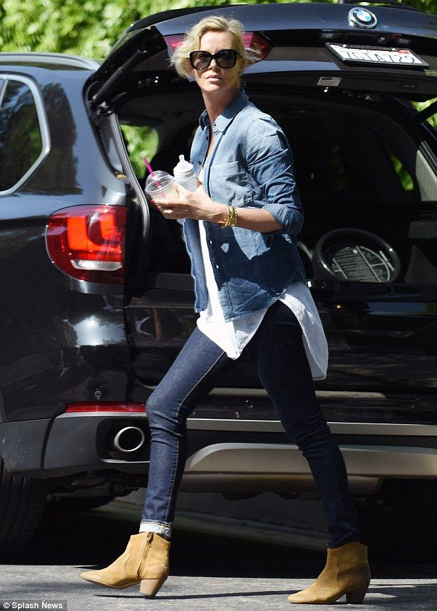 Fashion forward: Charlize Theron looked chic in double denim while on mom duty in Beverly Hills on Saturday, as she was seen taking her children to a birthday party