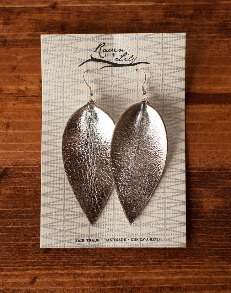 "Metallic leaf-inspired earrings are a simple way to make a striking statement. Empowering marginalized women in Northern India. Color ways available below. Earrings are 3.5"" long and 1.25"" wide. All r"
