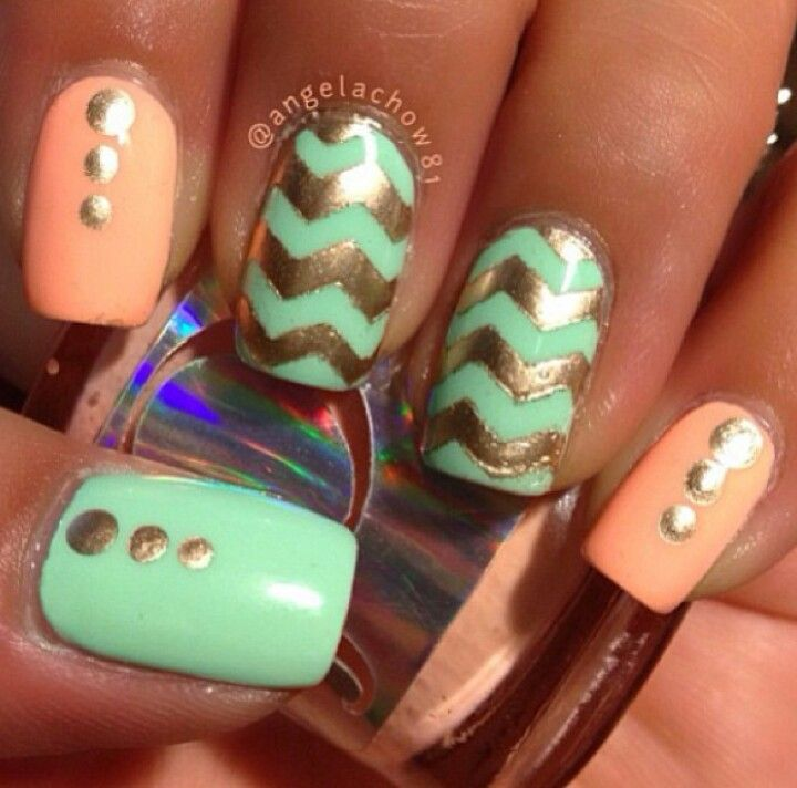 Mint and coral chevron nails