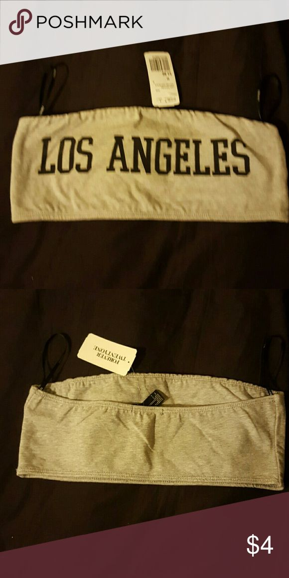 Los Angeles gray bandeau A grey bandeau top from f21 that says Los Angeles in black letters. Size medium #nwt never worn Forever 21 Tops Crop Tops