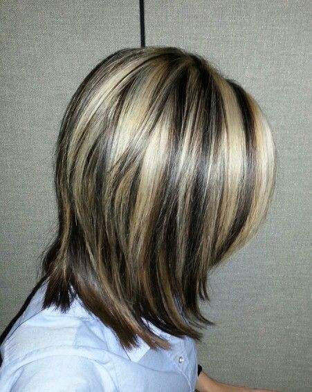 Brown hair with blonde streaks. Done at Textures Salon in Simcoe Ontario.