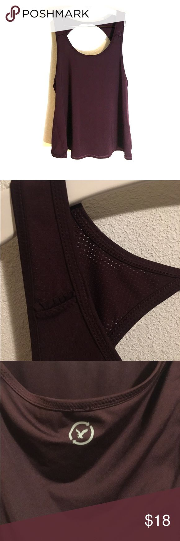 American Eagle maroon work out tank top This is an maroon American Eagle work out tank top size medium. It is a flexible spandex material and the upper back and shoulder straps are mesh and see through. The top of the back has a circular open cut out, and as pictured in the fourth image the back pieces drape over each other. Worn once and willing to discount with bundle. 🌷 American Eagle Outfitters Tops Tank Tops